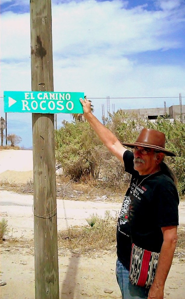 Area man proudly displays self-named street sign, actually it's not named after him, and the sign did not name itself, but you get the idea.