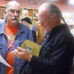 Me at a book signing with my famous friend, Pat Nolan, novelist, poet, book binder, block printer, editor, translator, who thinks my stuff is like Family Circus.